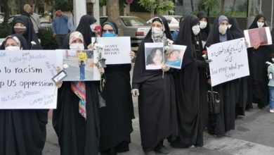 Photo of Iranian university students gather outside Swiss Embassy to slam US brutality against Afro-Americans